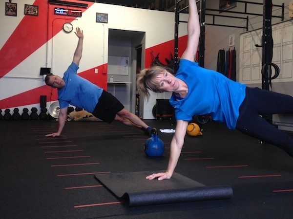 A man and a woman exercising